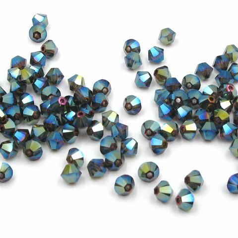 Xilion Bicone - Crystal Iridescent Green 2x - 4 mm, 20 ks