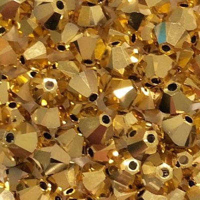 Xilion Bicone - Crystal Aurum 2x - 4 mm, 20 ks